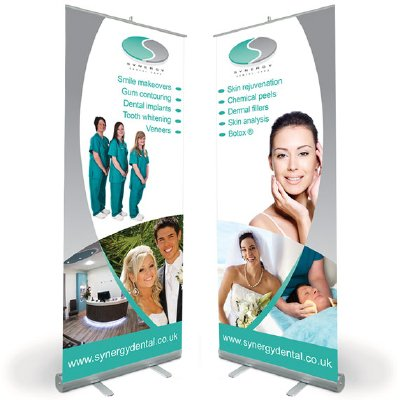 Two pop up banner designs for Synergy Dental. Designed by am:pm graphics.
